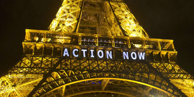 """The Eiffel Tower lights up with the slogan""""Action Now""""referring to the COP21, United Nations Climate Change Conference in Paris, Sunday, Dec. 6, 2015. Negotiators adopted a draft climate agreement Saturday that was cluttered with brackets and competing options, leaving ministers with the job of untangling key sticking points in what is envisioned to become a lasting, universal pact to fight global warming. (AP Photo/Michel Euler)"""