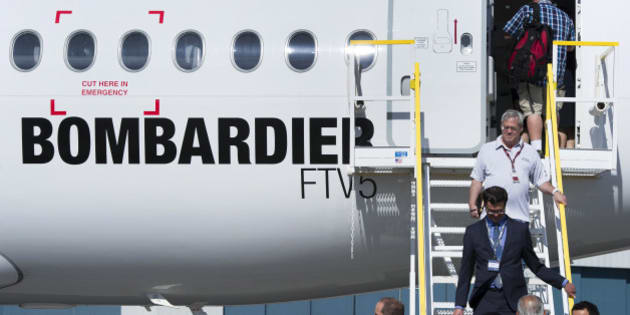 Attendees exit the new Bombardier Inc. CS100 airplane during an event at the company's facility in Toronto, Ontario, Canada, on Thursday, Sept. 10, 2015. Bombardier Inc. is refocusing the sales campaign for its tardy CSeries jet on established, 'marquee' airlines, a shift away from reliance on lessors and small carriers. Photographer: Kevin Van Paassen/Bloomberg via Getty Images