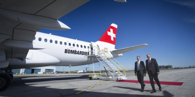 Rob Dewar, vice president of CSeries program for Bombardier Aerospace, right, and Fred Cromer, president of commercial aircraft for Bombardier Aerospace Corp., walk in front of the new Bombardier Inc. CS100 airplane during an event at the company's facility in Toronto, Ontario, Canada, on Thursday, Sept. 10, 2015. Bombardier Inc. is refocusing the sales campaign for its tardy CSeries jet on established, 'marquee' airlines, a shift away from reliance on lessors and small carriers. Photographer: Kevin Van Paassen/Bloomberg via Getty Images