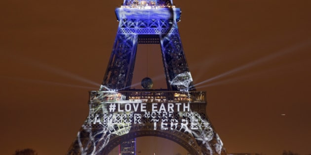 PARIS, FRANCE - NOVEMBER 29:  An artwork entitled 'One Heart One Tree' by artist Naziha Mestaoui is displayed on the Eiffel tower in the lead up to the Conference on Climate Change COP21 on November 29 in Paris, France. The climate change conference COP21 will gather 193 countries in Paris from November 30 to December 11, 2015.  (Photo by Chesnot/Getty Images)