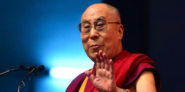 Tibetan spiritual leader, The Dalai Lama gestures as he addresses the gathering during the foundation stone laying ceremony of the Nimhans Integrated Centre for Yoga in Bangalore on December 7, 2015. AFP PHOTO/ Manjunath KIRAN / AFP / Manjunath Kiran        (Photo credit should read MANJUNATH KIRAN/AFP/Getty Images)