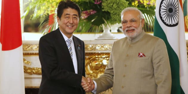 India's Prime Minister Narendra Modi, right, and Japan's Prime Minister Shinzo Abe shake hands before their talks at the state guest house in Tokyo Monday, Sept. 1, 2014. (AP Photo/Toru Hanai, Pool)