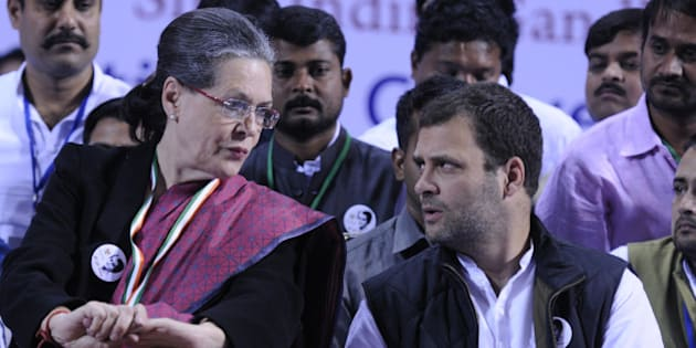 NEW DELHI, INDIA - NOVEMBER 19: Congress President Sonia Gandhi talking with Congress Vice President Rahul Gandhi during a convention of the Indian Youth Congress here to mark the 98th birth anniversary of former prime minister Indira Gandhi at Jawaharlal Nehru Stadium on November 19, 2015 in New Delhi, India. Congress president Sonia Gandhi and her son and party vice president Rahul Gandhi hit out at the government as well as the BJP and RSS accusing the Modi government of pursuing communal and divisive politics.( Photo by Sonu Mehta/Hindustan Times via Getty Images)