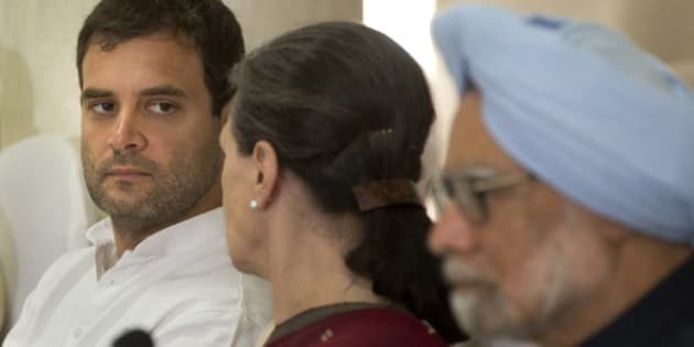 India's outgoing prime minister Manmohan Singh, sits on the right as Congress party president Sonia Gandhi, center, talks to her son and party vice president Rahul Gandhi, left, during a meeting of the Congress Working Committee to review the party's defeat in the general elections in New Delhi, India, Monday, May 19, 2014. The long-dominant Congress party was swept from power after the Hindu nationalist Bharatiya Janata Party (BJP) won the most decisive election victory India has seen in three decades. The BJP had won 282 seats and Congress just 44 in the 543-strong Lok Sabha, or lower house of Parliament. (AP Photo/ Manish Swarup)