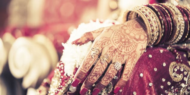 Mehendi is one of the Pre-wedding Ceremonies in Hindu weddings. Mehendi (Henna) leaves are crushed in to a paste and applied on the hands and feet of the bride before the wedding. It leaves a temporary Orange colour behind, when washed. The mehendi is applied in the form intricate design. It is believed if the colour of the mehendi is deep and nice, then the marriage will be strong and last for ever.Mehendi Designs have taken an art form and women decorate their palms and feet during various festivals like Teej, Karwa chowth, Diwali, Bhai dooj etc.This is the hand of a Indian Bride which was artfully decorated with Mehendi and Jewellery .