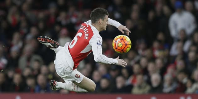 Arsenal's Laurent Koscielny goes down after a challenge from Sunderland's Ola Toivonen during the English Premier League soccer match between Arsenal and Sunderland at the Emirates Stadium in London, Saturday Dec. 5, 2015. (AP Photo/Tim Ireland)