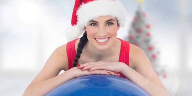 festive fit brunette leaning on ...