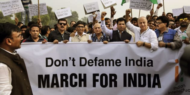 Bollywood actor Anupam Kher, third from right, and other supporters of India's ruling Bharatiya Janata Party march toward the Rashtrapati Bhawan or Presidential Palace during a protest in New Delhi, India, Saturday, Nov. 7, 2015. Kher on Saturday led a march to counter the protests by writers, artists and others who say they are alarmed by a climate of religious intolerance and violence in India. (AP Photo/Altaf Qadri)