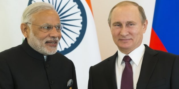 Russian President Vladimir Putin, right, and Indian Prime Minister Narendra Modi pose for photo during a meeting of leaders of BRICS prior the G-20 Summit  in Antalya, Turkey, Sunday, Nov. 15, 2015. (AP Photo/Alexander Zemlianichenko)