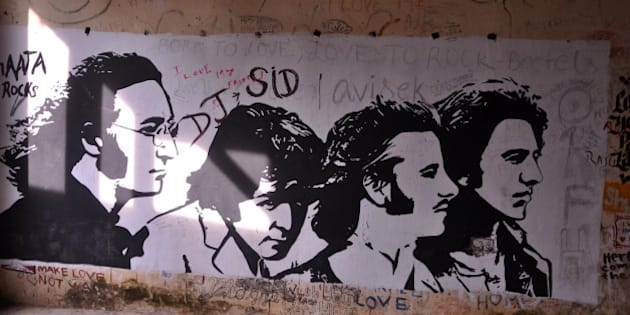This photograph taken on December 8, 2015 shows graffiti painted on the walls of a hall at the Beatles ashram, as the former ashram of the self-styled guru Maharishi Mahesh Yogi is known, in Rishikesh.  An abandoned spiritual retreat in northern India where The Beatles famously learned to meditate has been opened to the public, with plans to turn it into a touristy yoga centre, on December 8, 2015.  AFP PHOTO / AFP / STR        (Photo credit should read STR/AFP/Getty Images)