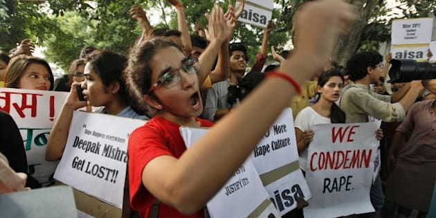 NEW DELHI, INDIA - OCTOBER 18: AISA (All India Students' Association) Students protest against the Delhi Police over the recent horrific twin rape cases of minors in the national capital, at Police Headquarters, on October 18, 2015 in New Delhi, India. The two-year-old was abducted from a religious event in west Delhi by two men on Friday night and raped before being dumped in a park near her home. In a separate incident on the same day, a five-year-old was also raped allegedly by three men in east Delhi, girl was reportedly alone at home when one of the accused, took her to his house and then allegedly raped her along with his friends. (Photo by Raj K Raj/Hindustan Times via Getty Images)