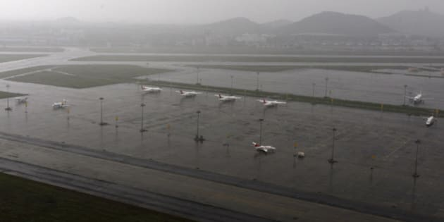 Aircrafts are seen parked in the waterlogged airport after heavy rainfall in Chennai, India, Saturday, Dec. 5, 2015. Although floodwaters have begun to recede, vast swaths of Chennai and neighboring districts were still under 2 1/2 to 3 meters (8 to 10 feet) of water, with tens of thousands of people in state-run relief camps. (AP Photo/Arun Sankar K)
