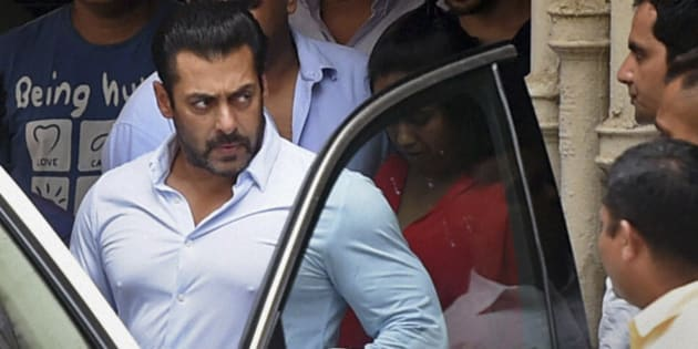 INDIA OUT - Bollywood actor Salman Khan leaves home for court in Mumbai, India, Friday, May 8, 2015. A court on Friday granted bail to Khan, one of India's biggest movie stars, until it hears his appeal challenging his conviction in a drunk-driving hit-and-run case more than a decade ago. (Shashank Parade/Press Trust of India via AP)