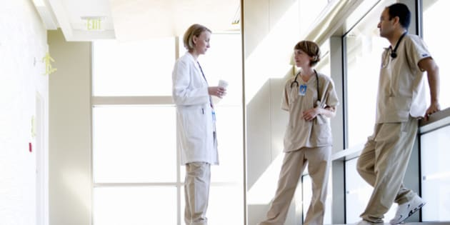 Doctor and nurses discussing in hospital corridor