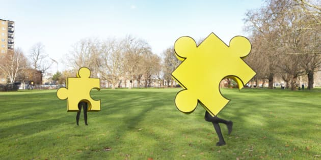 Two puzzle pieces running in the park