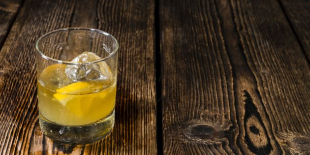 Fresh made Cocktail (Whiskey Sour) on dark wooden background