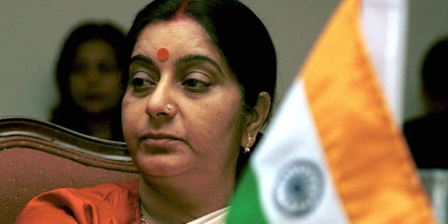 India's Broadcast Minister Sushma Swaraj sits behind an Indian flag as she attends a session of  the Information Ministers Conference of South Asian Association for Regional Cooperation (SAARC) in Islamabad, Pakistan, on Friday, March 8, 2002.   (AP Photo/Tariq Aziz)