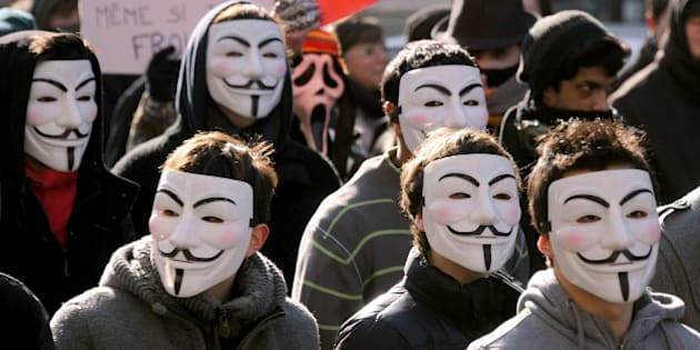 Demonstrators wearing Anonymous Guy Fawkes masks attend a protest against the Anti-Counterfeiting Trade Agreement (ACTA) on February 11, 2012 in Paris. Protesters have adopted as their own the now-iconic wryly smiling, mustachioed Guy Fawkes cartoon character masks of the global hacker group Anonymous. ACTA's aim is to beef up international standards for intellectual property protection, for example by doing more to fight counterfeit medicine and other goods. But it is ACTA's potential role in cyberspace that has caused outcry online and on the streets. AFP PHOTO JOHANNA LEGUERRE (Photo credit should read JOHANNA LEGUERRE/AFP/Getty Images)