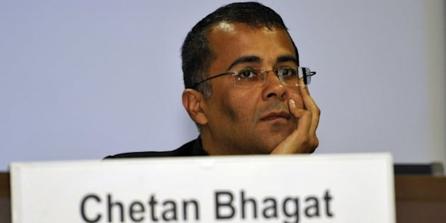 NEW DELHI, INDIA - JUNE 2: Author Chetan Bhagat during a conclave Sampark, Samanvya avam Samvad (Connect, Coordinate and Communicate) being organized for the officers of Ministries of Power, Coal and New & Renewable Energy, at Convention Hall, NDMC, Parliament Street, on June 2, 2014 in New Delhi, India. (Photo By Sonu Mehta/Hindustan Times via Getty Images)