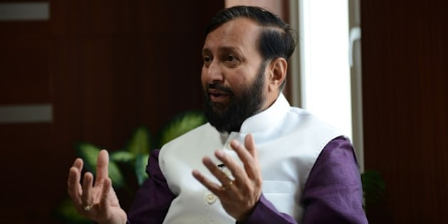 To go with 'Climate-Warming-UN-COP21-India' by Annie Banerji  In this photograph taken on November 19, 2015, India's Minister of Environment, Forests and Climate Change Prakash Javadekar gestures as he speaks during an interview with AFP at Indira Paryavaran Bhawan in New Delhi.  India will urge rich nations to deliver 'climate justice' for developing countries at a major environmental conference in Paris later this month, the environment minister has said in an interview with AFP. Prakash Javadekar called on industrialised countries to commit to more stringent targets to free up 'carbon space' for the developing world to generate emissions as a necessary byproduct of growth.  AFP PHOTO/Money SHARMA        (Photo credit should read MONEY SHARMA/AFP/Getty Images)