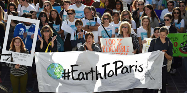 Environmental activists and supporters during a rally calling for action on climate change in Los Angeles, California on November 29, 2015, a day before the start of the COP21 conference in Paris. Some 150 leaders, including US President Barack Obama, China's Xi Jinping, India's Narendra Modi and Russian President Vladimir Putin, will attend the start of the Paris conference, which is tasked with reaching the first truly universal climate pact, with the goal to limit average global warming to two degrees Celsius (3.6 degrees Fahrenheit), perhaps less, over pre-Industrial Revolution levels by curbing fossil fuel emissions blamed for climate change.       AFP PHOTO/ MARK RALSTON / AFP / MARK RALSTON        (Photo credit should read MARK RALSTON/AFP/Getty Images)
