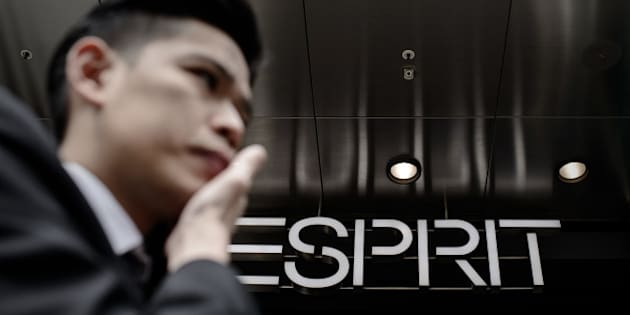 A man walks past an Esprit shop in Hong Kong on February 21, 2014. Esprit has swung back to profit in the first half of fiscal year, compared to net loss of 465 million HKD for the same period of the last financial year. AFP PHOTO / Philippe Lopez        (Photo credit should read PHILIPPE LOPEZ/AFP/Getty Images)