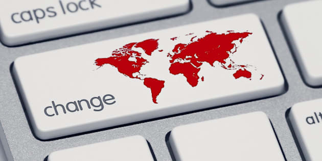 An extreme close-up of a keyboard, focused on the shift key which now says 'change' and has a red map of the world.