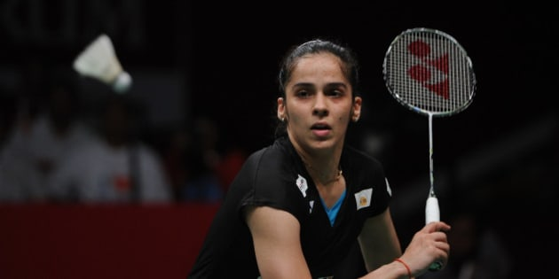 JAKARTA, INDONESIA - AUGUST 16: Saina Nehwal of India competes against Carolina Marin of Spain in the women singles final match of the 2015 Total BWF World Championship at Istora Senayan on August 16, 2015 in Jakarta, Indonesia.  (Photo by Robertus Pudyanto/Getty Images)