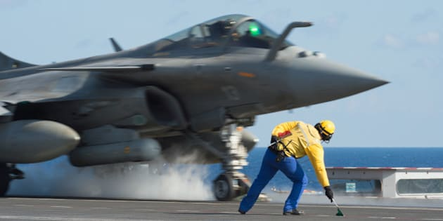 CAPTION CORRECTS THE SLUG - This photo released on Monday, Nov. 23, 2015 by the French Army Communications Audiovisual office (ECPAD) shows a French army Rafale fighter jet taking off from the deck of France's aircraft carrier Charles De Gaulle, in the Mediterranean sea. The French Defense Ministry says it has launched its first airstrikes from the aircraft carrier Charles de Gaulle, bombing Islamic State targets in the Iraqi cities of Ramadi and Mosul. (Defense Ministry/ECPAD via AP)       THIS IMAGE MAY ONLY BE USED FOR 30 DAYS FROM TIME TRANSMISSION.