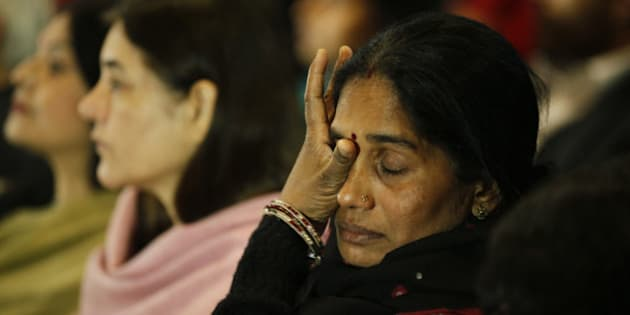 NEW DELHI, INDIA - DECEMBER 16: Mother of Nirbhaya gets emotional at a prayer meeting to remember Nirbhaya on the second anniversary of the fatal gang-rape organized by Nirbhaya Jyoti Trust at Rajendra Bhawan on December 16, 2014 in New Delhi, India. On December 16, 2012, a 23-year-old physiotherapy student was brutally gang raped and by six men, including a juvenile, in a moving bus. The incident unleashed a wave of public anger over levels of violence against women in the country. Nirbhaya Jyoti Trust which was established by Nirbhayas parents (Photo by Raj K Raj/Hindustan Times via Getty Images)
