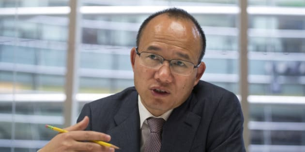 Billionaire Guo Guangchang, chairman and chief executive officer of Fosun Group, speaks during an interview in New York, U.S., on Thursday, April 23, 2015. Guo is the largest shareholder of Shanghai-based Fosun Group, China's biggest closely-held investment firm, with interests in real estate, retailing and gold mining. Photographer: Michael Nagle/Bloomberg via Getty Images