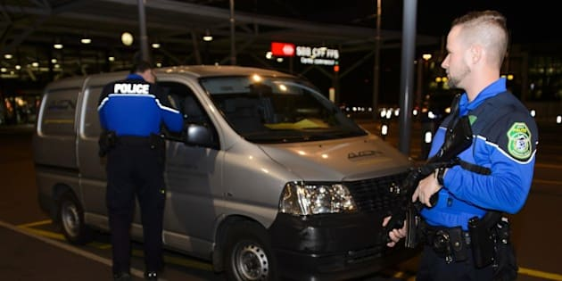 Security forces stop a van at the check vehicles arriving at Geneva's airoport on December 10, 2015, after police raised the alert level and searched the city for several suspected jihadists believed to have links to the Islamic State (IS) group, security sources said.   Security services in the Canton of Geneva said they received information on December 9 from Swiss federal authorities about suspicious individuals in the Geneva area. The Tribune de Geneve, in an unconfirmed report, said the intelligence originally came from the United States.  / AFP / Richard Juilliart        (Photo credit should read RICHARD JUILLIART/AFP/Getty Images)