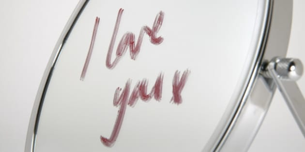 Detail view of the words ?I love you? written on a mirror in lipstick