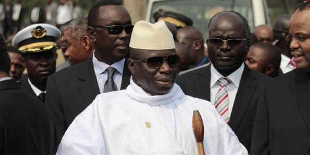 Gambian President Yahya Jammeh stands outside the Sipopo Conference Center outside Malabo, Equatorial Guinea, ahead of the opening session of the 17th African Union Summit, Thursday, June 30, 2011. Foreign military intervention has caused massive suffering in Africa and should only be carried out with the consensus of African nations, Equatorial Guinea President Teodoro Obiang Nguema said Thursday at the opening of the body's biannual summit.(AP Photo/Rebecca Blackwell)