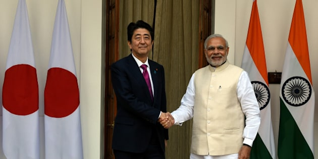 India's Prime Minister Narendra Modi (R) shakes hands with Japan's Prime Minister Shinzo Abe before a meeting at Hyderabad House in New Delhi on December 12, 2015. Indian Prime Minister Narendra Modi and his Japanese counterpart Shinzo Abe are expected to discuss deals covering high-speed rail, defence and civilian nuclear technology when they hold talks.   AFP PHOTO / Money SHARMA / AFP / MONEY SHARMA        (Photo credit should read MONEY SHARMA/AFP/Getty Images)