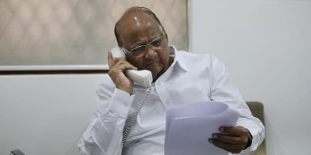 MUMBAI, INDIA - APRIL 1: Nationalist Congress Party (NCP) Chief and Union Agriculture Minister Sharad Pawar gestures while he speaks on an interview at his residence in Breach Candy on April 1, 2014 in Mumbai, India. Commenting on Shiv Sena chief Uddhav Thackerays claim that he stalled the NCPs entry into the BJP-led NDA, Sharad Pawar termed it the joke of the year. (Photo by Kalpak Pathak/Hindustan Times via Getty Images)