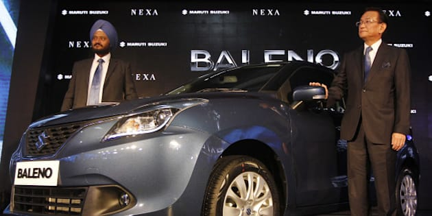 NEW DELHI, INDIA - OCTOBER 26: Managing Director and CEO of Maruti Suzuki, Kenichi Ayukawa along with RS Kalsi (Executive Director, Marketing & Sales) poses with the new Maruti Suzuki, Baleno car, during its launch on October 26, 2015 in New Delhi, India. Maruti Suzuki India will for the first time export a made-in-India car to Japan, the home of parent Suzuki Motor Corp. in a move that could lead to India becoming a Suzuki export hub. The company will begin exporting it to 100 countries including Japan and Europe from early 2016 as it works to establish itself alongside more upmarket global automakers. (Photo by Virendra Singh Gosain/Hindustan Times via Getty Images)