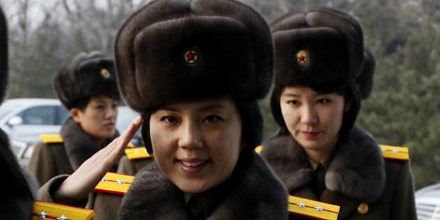 Members of the Moranbong Band and the State Merited Chorus of North Korea leave the station in Pyongyang, North Korea, Wednesday, Dec. 9, 2015. They give friendship performances in China. (AP Photo/Kim Kwang Hyon)