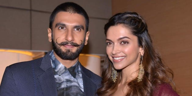 Indian Bollywood actor Ranveer Singh (L) and actress Deepika Padukone pose during a promotional event for the forthcoming Hindi film 'Bajirao Mastani' in Amritsar on December 11, 2015. AFP PHOTO / NARINDER NANU / AFP / NARINDER NANU        (Photo credit should read NARINDER NANU/AFP/Getty Images)