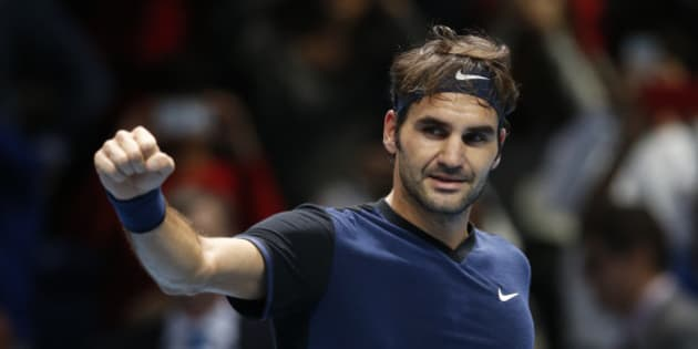 Roger Federer of Switzerland celebrates after defeating Kei Nishikori of Japan after their singles tennis match at the ATP World Tour Finals at the O2 Arena in London, Thursday, Nov. 19, 2015. (AP Photo/Alastair Grant)