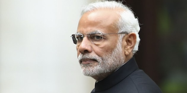 Indian Prime Minister Narendra Modi walks during a welcome ceremony outside the Treasury in London on November 12, 2015 on the first day of a three-day visit to Britain. India's Prime Minister Narendra Modi will meet Britain's Queen Elizabeth II and address a huge rally at London's Wembley Stadium during a three-day visit to Britain focused on trade and investment starting today. AFP PHOTO / JUSTIN TALLIS        (Photo credit should read JUSTIN TALLIS/AFP/Getty Images)