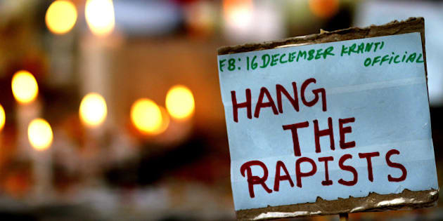 NEW DELHI, INDIA - DECEMBER 16: A placard calling for capital punishment for rapists is pictured beside a memorial at the protestors corner in Jantar Mantar on the second anniversary of the fatal gang-rape of a student on December 16, 2014 in New Delhi, India. On December 16, 2012, a 23-year-old physiotherapy student was brutally gang raped and by six men, including a juvenile, in a moving bus. The incident unleashed a wave of public anger over levels of violence against women in the country. (Photo by Arun Sharma/Hindustan Times via Getty Images)