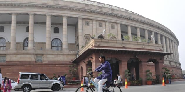 NEW DELHI, INDIA - DECEMBER 7: BJP Rajya Sabha MP Mansukh L Mandaviya arrives on his cycle at Parliament during the winter session on December 7, 2015 in New Delhi, India. The third week of the winter session of Parliament is likely to see the NDA government push for passage of key legislation including the GST Bill. (Photo by Mohd Zakir/Hindustan Times via Getty Images)