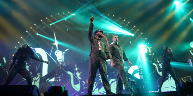 LONDON, ENGLAND - OCTOBER 17: Walshy Fire and Diplo  of Major Lazer perform at Alexandra Palace on October 17, 2015 in London, England.  (Photo by Burak Cingi/Redferns)