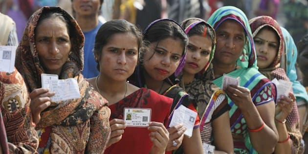 NEW DELHI, INDIA - FEBRUARY 7: Women in queue to cast their vote at Tughlakabad polling station, during the Delhi Assembly Elections 2015, on February 7, 2015 in New Delhi, India. Delhi is headed for a record turnout on Saturday as more than 69.5% of the city's 1.33 crore voters cast their ballot till 5pm. After a slow start in the morning, polling picked up around noon, with scores of people queuing up at booths to exercise their franchise in an electrifying electoral battle that the national capital has never witnessed before. 69.5 per cent of 1.3 voters had been inked by 5 pm on Saturday, as Delhi looked set for a record turnout after a slow morning. There are 673 candidates in the fray now. Voting is taking place in 11,763 centers, located in schools. Many initial voters in middle class and posh areas were early morning walkers. (Photo by Raj K Raj/Hindustan Times via Getty Images)