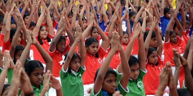 Indian schoolchildren take part in a yoga programme in Chennai on June 19, 2015, ahead of International Yoga Day on June 21.  Preparations in India have been gathering pace since the UN agreed to the day, with schools, military barracks and even jails encouraged to participate in their own sessions. AFP PHOTO/STR        (Photo credit should read STRDEL/AFP/Getty Images)