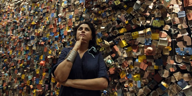 Indian artist Hema Upadhyay poses in front of her 'Think Left, Think Right, Think Low, Think Tight' installation at the Paris's Pompidou Centre on May 23, 2011 during an exhibition entitled 'Paris, Delhi, Bombay...' and devoted to the Indian art today. The event runs from May 25 to September 19, 2011. AFP PHOTO / PEIRRE VERDY (Photo credit should read PIERRE VERDY/AFP/Getty Images)