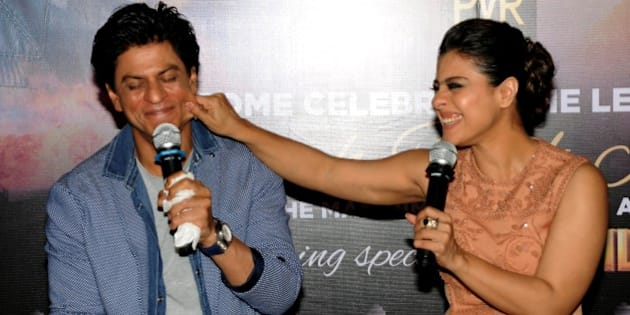 Indian Bollywood actors Shah Rukh Khan (L) and Kajol Devgn appear at a promotional event for their upcoming Hindi film 'Dilwale' in Mumbai on December 11, 2015. AFP PHOTO / AFP / STR        (Photo credit should read STR/AFP/Getty Images)