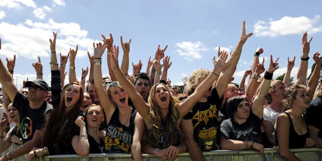 MELBOURNE, AUSTRALIA - MARCH 01: The front rows of the audience raise their arms and cheer in the sunshine at The Soundwave Music Festival at Flemington Race Course on 1st March 2013, in Melbourne, Australia. (Photo by Martin Philbey/Redferns)