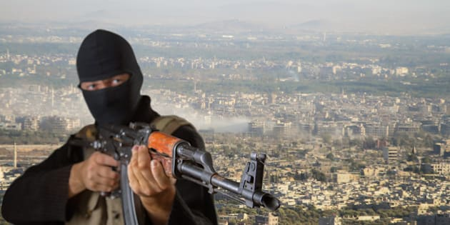 Actor posing as a terrorist. The image is a collage. Image of a man superimposed on the image of one of the districts of Damascus.